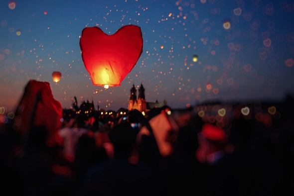 Image of heart-shaped lantern lifting into the sky