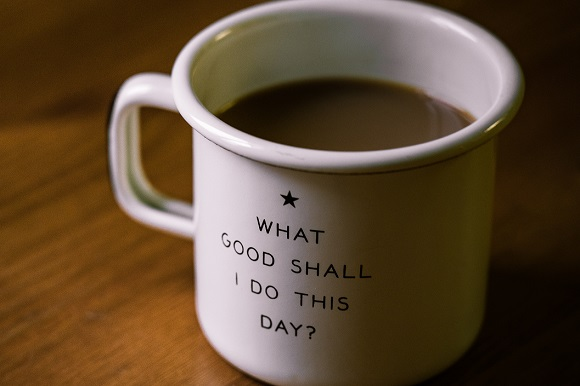 "Coffee cup with the words ""What good shall I do this day?"""