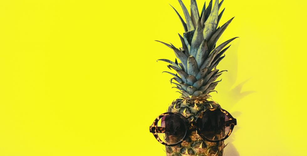 Pineapple on a bright yellow background
