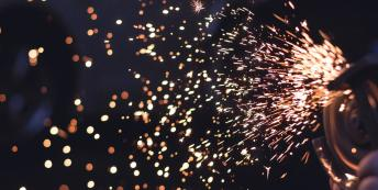 Image of sparks flying from grinder at night