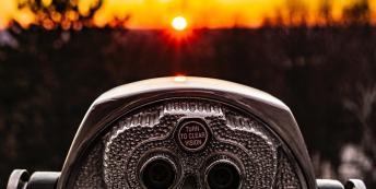Image of binoculars at sunset