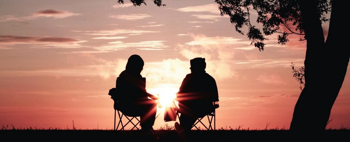 A conversation at sunset