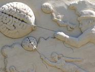 Image of sand sculpture people flying while holding brain balloons