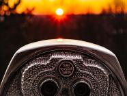 Image of binoculars at sunset