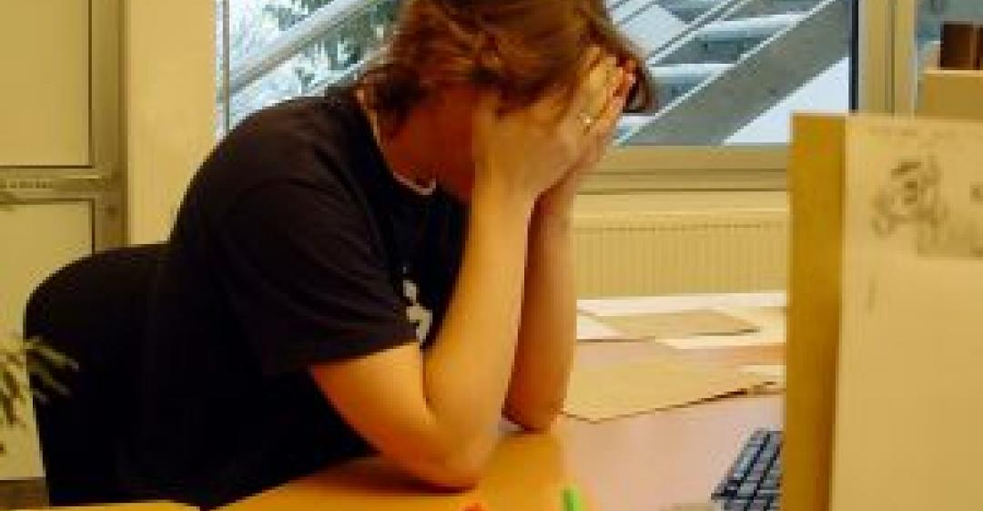 Image of stressed worker
